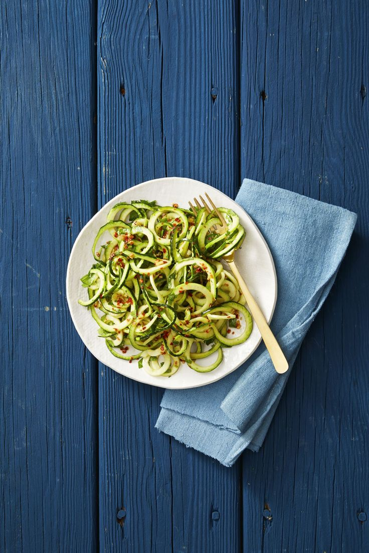 """These healthy, easy-to-cook strands of zucchini deliciousness (some people calls them """"zoodles"""") can do just about anything that noodles can do. Try out one of these zucchini noodle recipes for a healthy, low-calorie main course or side dish. Best Zucchini Noodles Recipe, Pesto Zucchini Noodles, Healthy Zucchini, Veggie Noodles, Kale Pesto, Healthy Side Dishes, Side Dishes Easy, Healthy Snacks, Healthy Eating"""