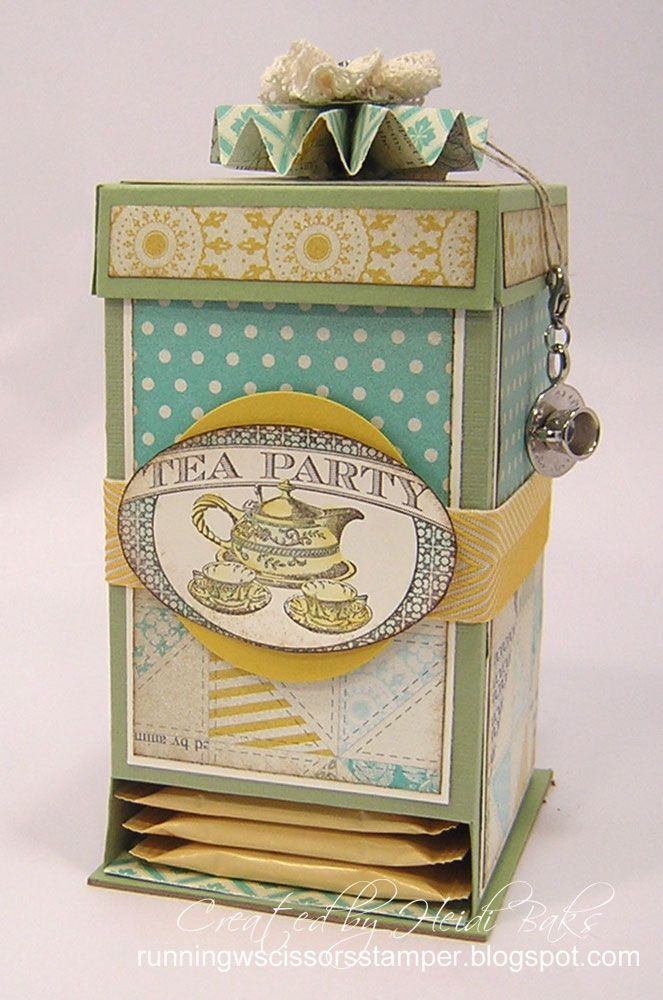 Tea bag dispenser box by Heidi Baks  (103013)  https://www.youtube.com/watch?v=Qq4We1WbJA  see also http://www.splitcoaststampers.com/resources/tutorials/teabagdispenserbox/  and  http://runningwscissorsstamper.blogspot.com/2012/01/tea-bag-dispenser-project-details.html