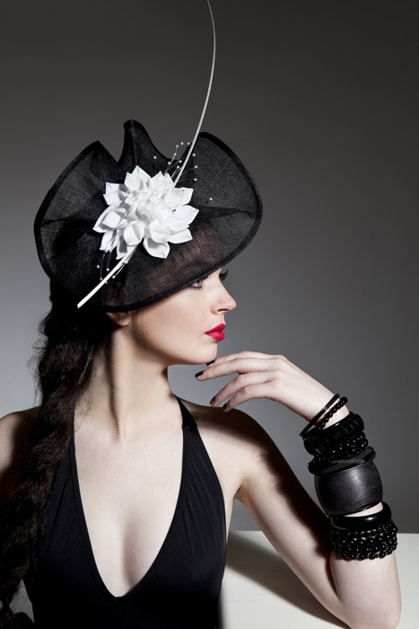 l love contrast, shape and proportion of this hat that draws attention to the lady's profile...Nicely done!