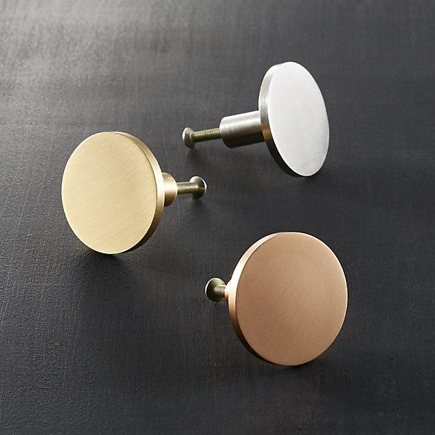 Shop circle knobs.   Minimalist shape adds a sophisticated graphic element to doors and drawers.  Handmade of solid brass, metallic knob ups the design factor of existing cabinets.