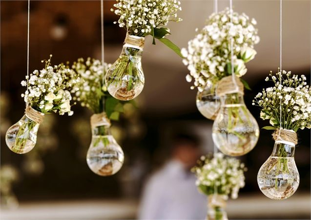 What an amazing DIY wedding decor idea! Use old lightbulbs as makeshift vases and suspend sprigs of flowers from the ceiling   Venue: Village Hotel Club Birmingham Dudley