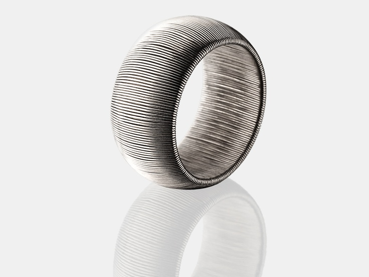 A single silver wire wraps the surface of the jewel, creating effects of rare elegance and special tactile perception. #jewelry #ring