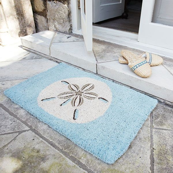 Sand Dollar Doormat for that coastal feel.  It's a shame to wipe your feel on such a lovely accessory.  #CurbAppealContest