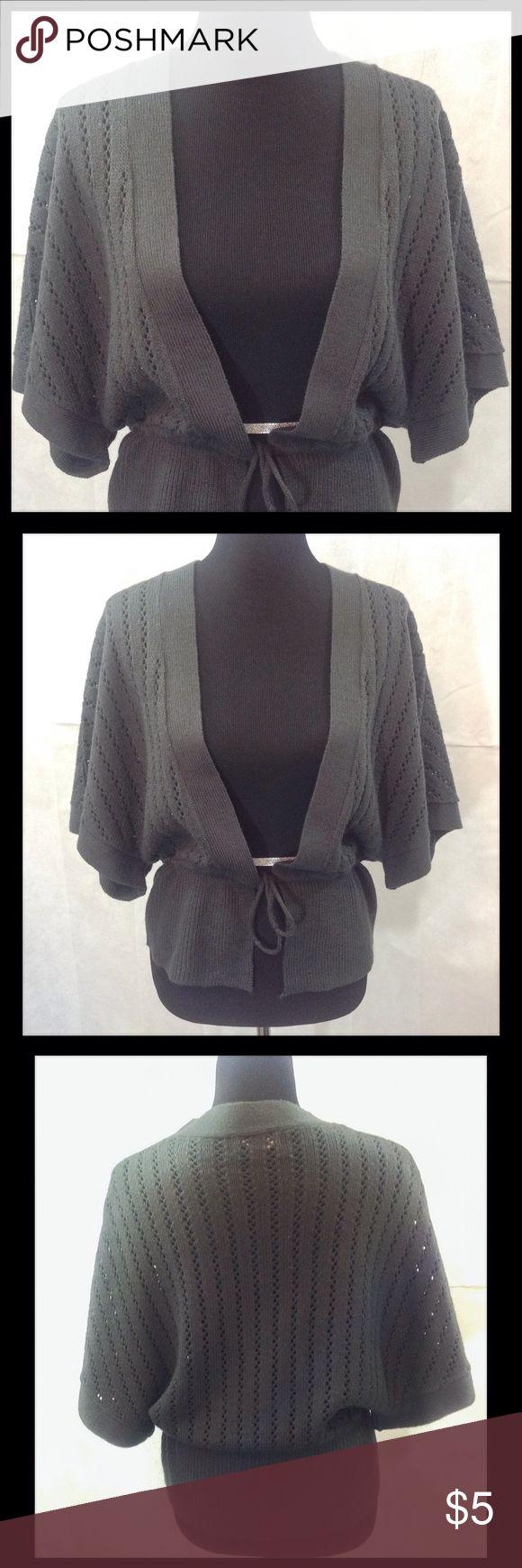 Grey Shrug Sweater Grey shrug sweater. Drawstring belted waist. GUC. 100% acrylic. Hand wash cold. Sweaters Shrugs & Ponchos