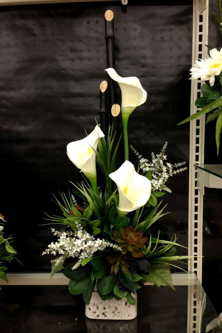 Bamboo and white Calla lilies arrangement