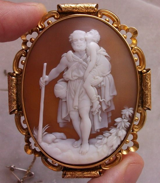 Circa 1850/1960 Sardonyx Shell, 15k gold Italian cameo depicting St. Christopher.  Saint Christopher is a saint venerated by Orthodox Christians, listed as a martyr killed in the reign of the 3rd century Roman emperor Decius (reigned 249–251).