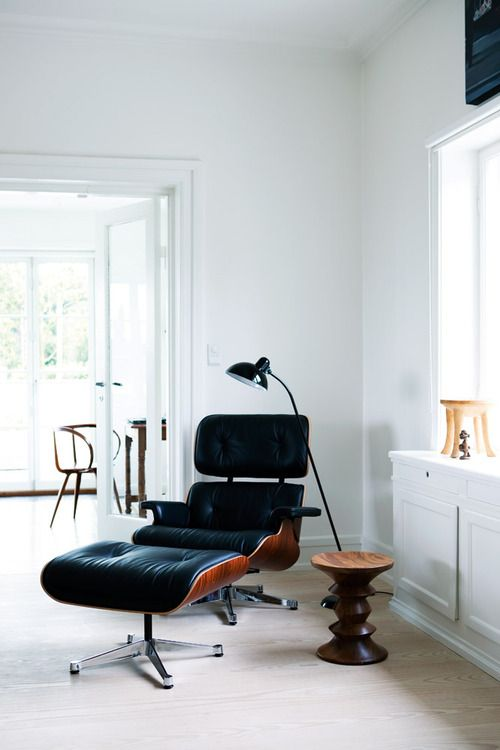 Lovely environment.  Eames lounge chair and ottoman and Eames walnut stool by Vitra