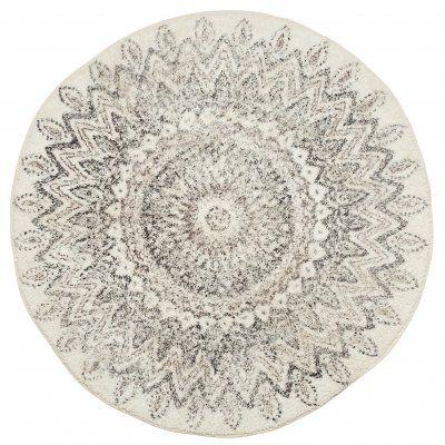 Snygg och mjuk rund matta i offwhite med snyggt brunt och svart blomformat mandala-mönster. Snygg matta att tex ha i badrummet!