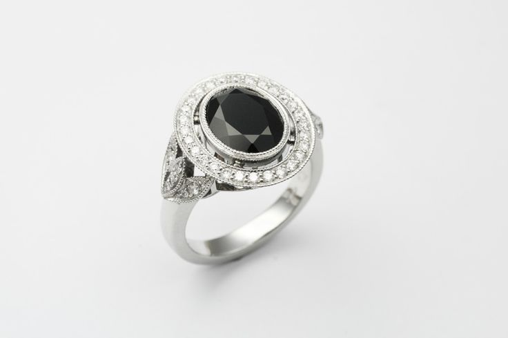 Stunning custom made vintage style engagement ring with diamond halo