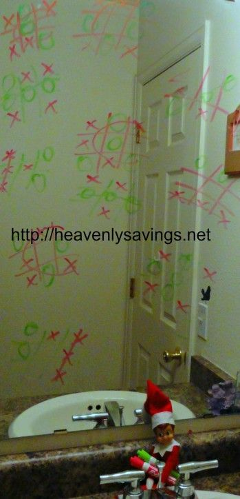 50 elf on the shelf ideas | princess among superheroes dry eraser on mirror with marker in hand leaving the kids a note