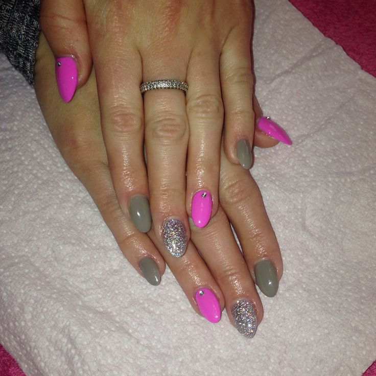 Grey and pink gel polish with silver glitter acrylic