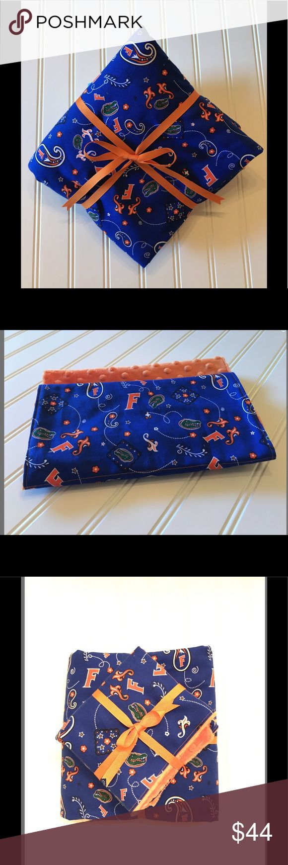 Baby Blanket, stroller blanket, baby girl,baby boy This blanket the perfect baby shower gift for the new baby in your life! The blanket is soft and cuddly with a minky dot back. The front is Florida Gator print blue/orange and back orange minky dot. Great for the car seat, stroller, tummy time or cuddling!  Matching burp cloths✅  Love the University of Florida colors? I'm happy to create something custom.  If your item is a gift, please let me know and I'll include your personalized message…