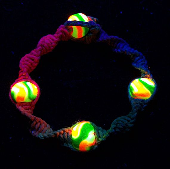 Express your mutated radioactive qualities with this Super glowy, super trippy full spectrum DNA strand rainbow bracelet!  We started this bracelet with 2 strands of 100 pound test hemp for the middle strings, making it super phat and durable.  We wrapped it in a continuous DNA spiral with bright rainbow spectrum hemp that gradients from red to orange, yellow, green, blue, purple and back to red in a perfect prism. Its 12ply and super soft. This hemp has been non-toxic dyed with quality hemp…