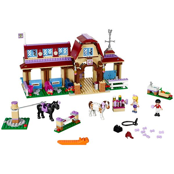 LEGO Friends - Heartlake Riding Club and over 7,500 other quality toys at Fat Brain Toys. Get competition-ready at the Heartlake Riding Club with a rotating exerciser and practice jump, stables, changing room, cafeteria, bedroom, 2 mini-dolls and 2 horses.