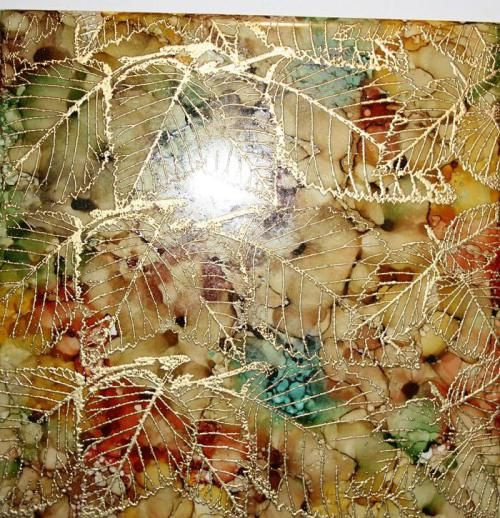 Using gold embossing powder rubber stamped over alcohol ink on ceramic tile tiffanyleaf