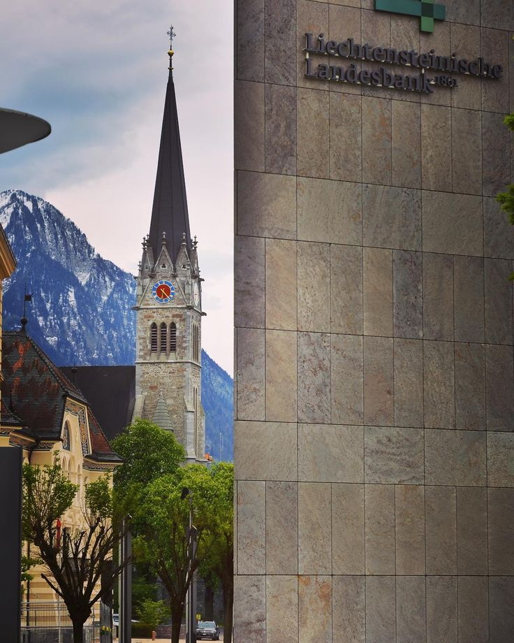 St. Fiorin | Liechtensteinische Landesbank ���� #vaduz #liechtenstein #bank #stfiorin #church #kirche #kathedrale #berge #alpen #mountains #горы #альпы #лихтенштейн #церковь #банк #travel #travelgram #instatravel #instadaily #instalike #instagood #instagram #instagramde #instagramrussia #путешествие #путешествия http://tipsrazzi.com/ipost/1507172202486044078/?code=BTqjSIAhhWu