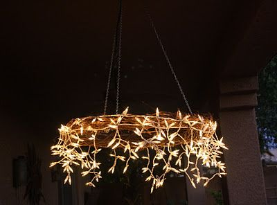 Instructions for a Stunning DIY chandelier perfect for rustic weddings-Icicle lights with a grape vine wreath.  Would be beautiful in a back yard in the summer on a patio too...wedding decor, decorations, budget.