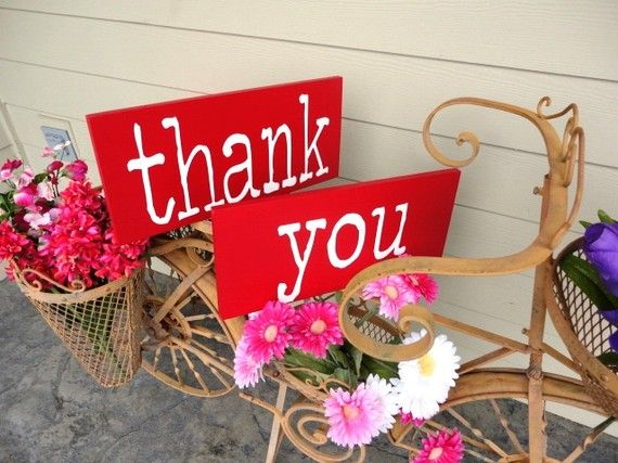 Red Thank You signs.