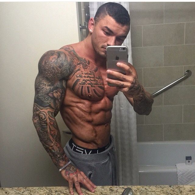 Fit men with tattoos