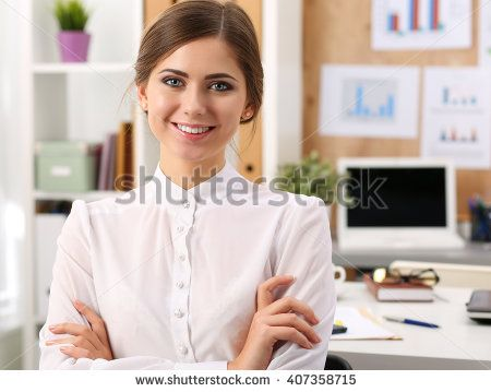 Beautiful smiling businesswoman standing in office with hands crossed on chest portrait. Serious business, exchange market, job offer, excellent education, certified public accountant concept