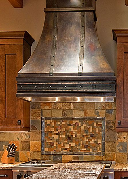 custom bronze range hood with handforged steel detailing love the hood