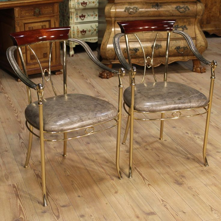 Price: 850€  Pair of design armchairs, of the 20th-century from Spain. Furniture made by gilt metal with back made by mahogany. Seating and armrests covered with gray faux leather in good condition. Height of seat 46 cm. They show some signs of aging on the whole in good state of conservation. #antiques #antiquariato Visit our website www.parino.it