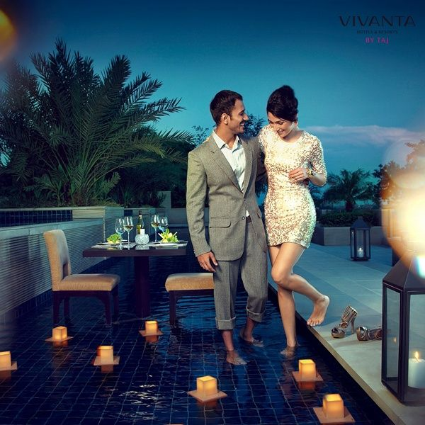 Toss your shoes & enjoy an alluring experience in the infinite pool at Vivanta by Taj – Surajkund with your partner.  #RenewalofVows #Couple #Love #Dinner #Surprise #Romantic #Pool