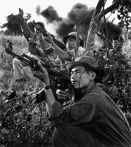 North Vietnamese Army soldiers fire on U.S. Army helicopters. This was most likely a staged photo.:
