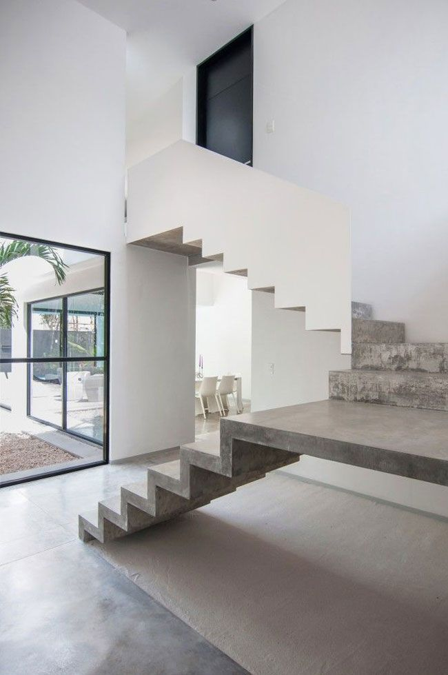Escalier design béton et blanc https://sorsluxe.com/sors-blog/2017/2/1/8-heavenly-staircase-designs