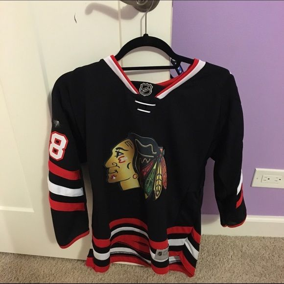 Reebok Blackhawks jersey Very cute! Bought at Clark Streets Sports! No trades, need to earn back the money. price negotiable. Youth L/XL. Tops