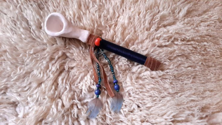 Blue pipe with leather, glass beads, lapis lazuli, guairuro seed (protection from negative energies) and blue parrot feathers www.facebook.com/MotherofWater
