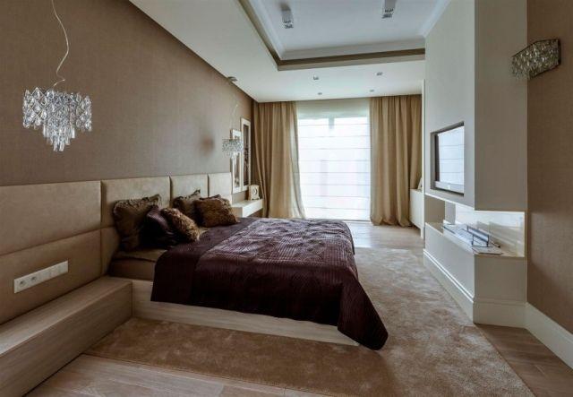 schlafzimmer modern hellbeige ethanol kaminofen tv wand eingebaut