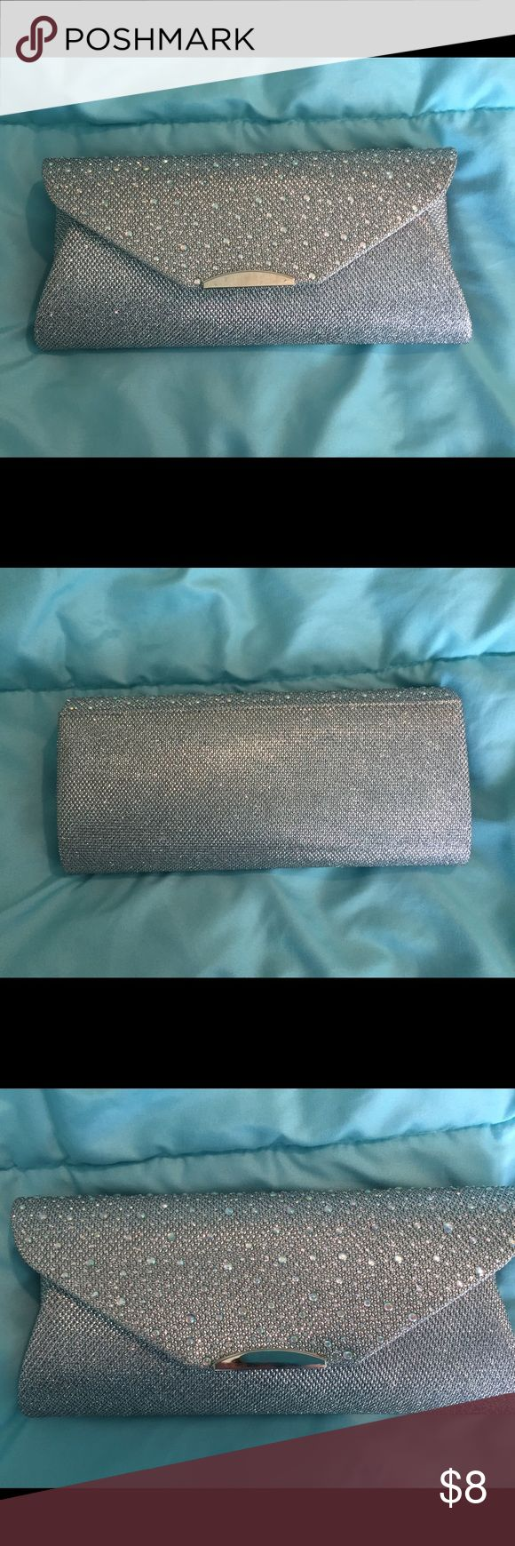 PRICE DROP! Sparkly Clutch/Handbag Sparkly silver clutch/handbag. Has two different strap options or can be carried as a clutch with no straps. In excellent condition, only used once for prom. Accessories