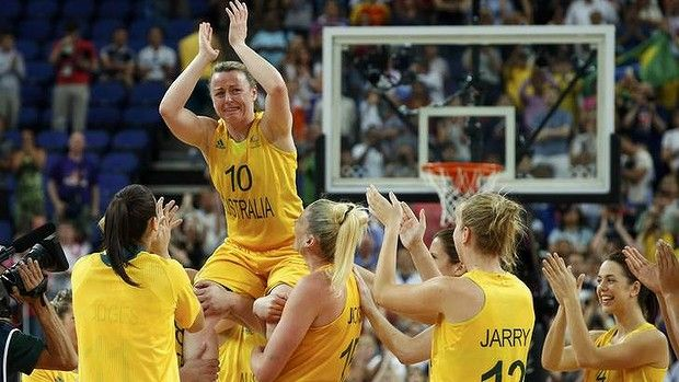 Kristi Harrower is hoisted by her teammates as they celebrate victory in their bronze medal match against Russia.