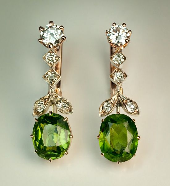 Russian Demantoid Drop Earrings, circa 1910. Russian Ural Mountain demantoids over 2 carats are very rare in general, and it is extremely rare to see jewelry with two well matched demantoids, over 2.5 ct each.  Handcrafted in silver and pink 14K gold, embellished with two bright white European cut diamonds and eight old mine diamonds.