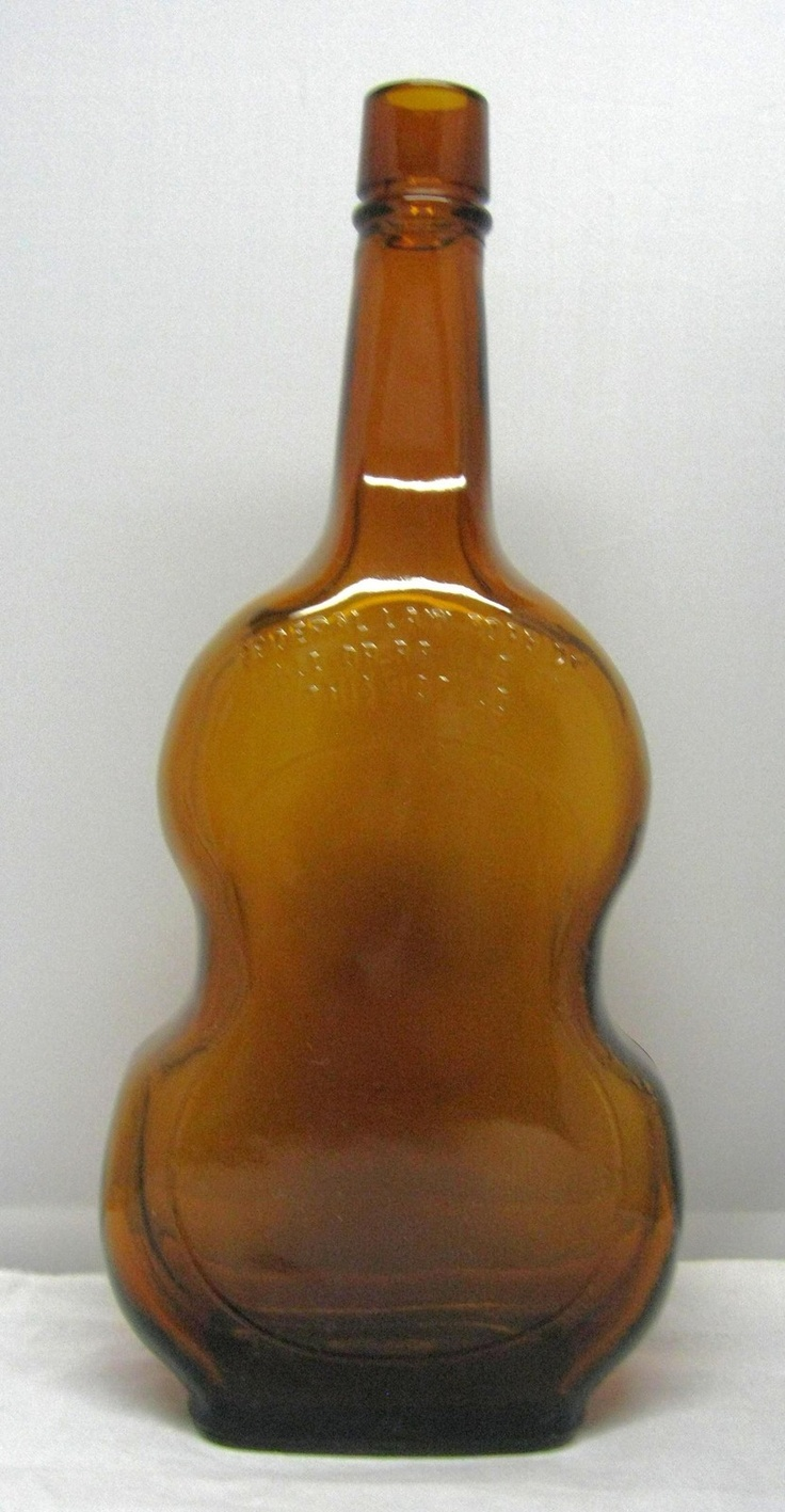 Vintage guitars amber color and whiskey bottle on pinterest for Retro glass bottles
