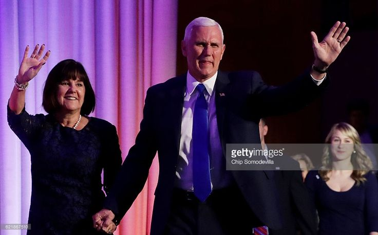 Vice president-elect Mike Pence walks on stage with his wife Karen Pence at Republican president-elect Donald Trump election night event at the New York Hilton Midtown in the early morning hours of November 9, 2016 in New York City. Americans went to the polls yerterday to choose between Republican presidential nominee Donald Trump and Democratic presidential nominee Hillary Clinton as they go to the polls to vote for the next president of the United States.