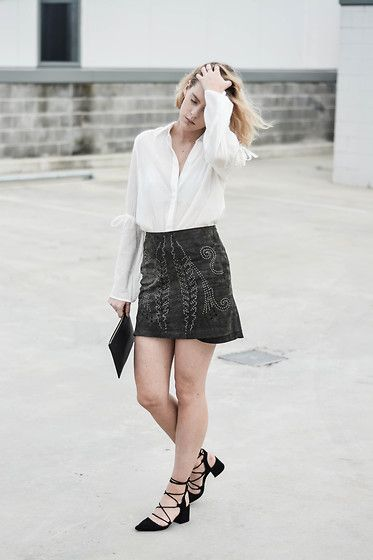 Get this look: http://lb.nu/look/8529169  More looks by Madelene: http://lb.nu/maddvv  Items in this look:  Livingstone Cooper White Shirt, Zara Detail Skirt, Zara Strap Heels   #chic #minimal #street #zara #whiteshirt #blogger