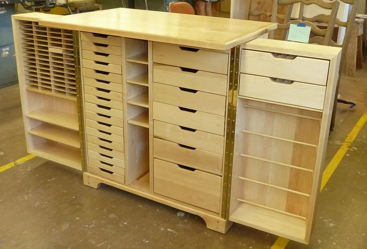 STORAGE WORKSPACE CABINET: the two sides, attached with piano hinges for strength, open up to…. 24 drawers for stamps, paper, embellishments or punches