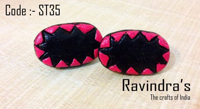 Pink and black handmade terracotta stud earrings.  Visit the page for further details :- https://www.facebook.com/photo.php?fbid=223802537777576=a.223800731111090.1073741827.223796264444870=1