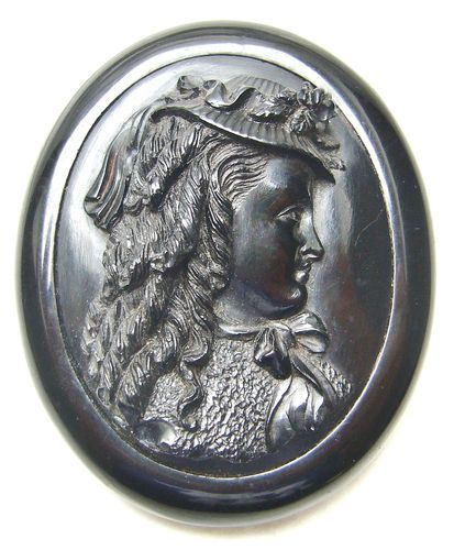 Whitby jet mourning jewelry  When Victoria went into mourning the need for non shiny black jewelry led to the rise and popularity of Whitby jet. Whitby a seaside tourist area had a deposit of this easily carved coal like substance.  The demand for Whitby jet totally cleared the deposit