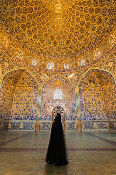 Iran Tourism Push: Iranian woman dressed in chador inside Sheikh Lotfollah Mosque