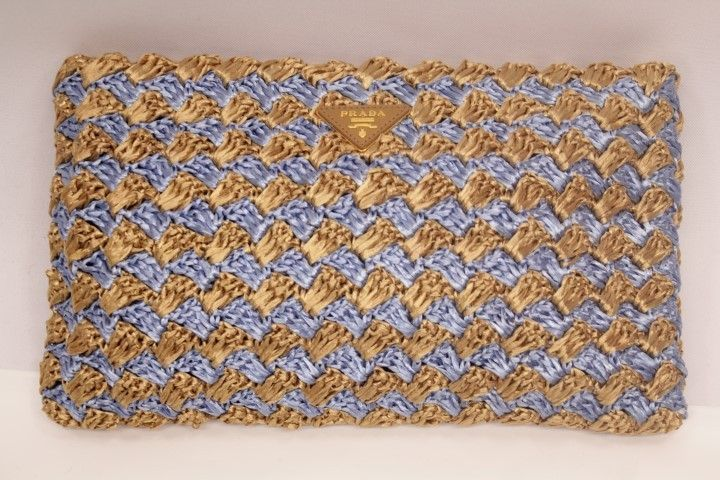 Just in! Prada Spring/Summer 2012 Large Crocheted Raffia Clutch Blue + Natural. Save up to 70% off retail at www.ShopKarma.com. High end pre owned designer bags, clothing, shoes and accessories. #karmacouture #shopkarma #upscaleresale #shopresale #consignment #designer #fashion #style #prada #handbags