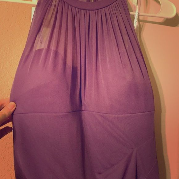 David's Bridal Bridesmaid Gown Size 6 worn one time for a wedding! Could use a dry clean otherwise perfect condition. Color is lilac I believe. The first picture is a true representation of color. Others are bad lighting I apologize. David's Bridal Dresses