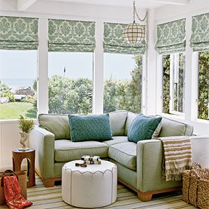 100 Comfy Cottage Rooms   Cozy Corner   CoastalLiving.com Sun room: corner sofa with foot stool. Moss green - soft tones / sea foam blue accents