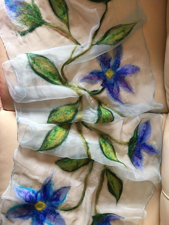 Felted by hand - Australian Merino Wool on 100% silk scarf. Using the Nuno Felting technique, the silk scarf is embellished with not only colorful wool, but also with Saree Silk accents. The handcrafted, personal designs create an elegant scarf for any occasion.
