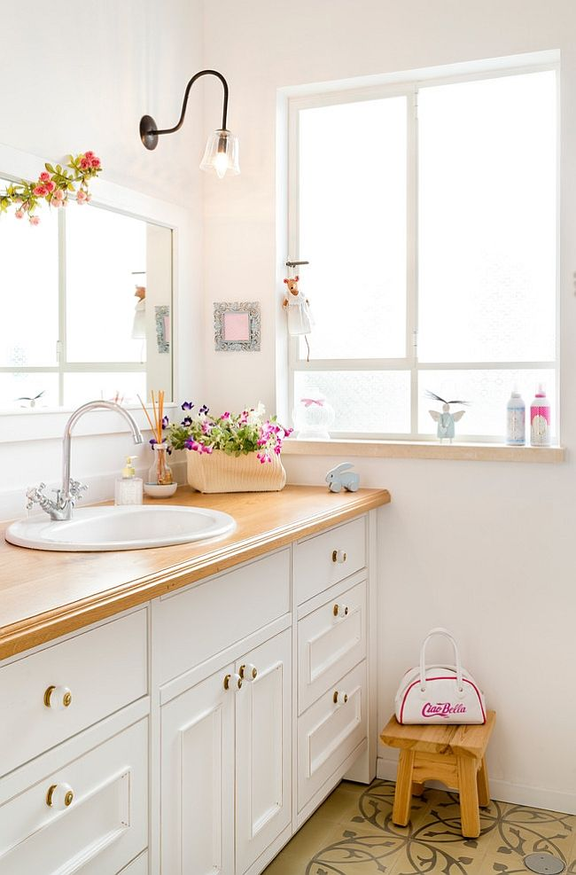 Flowers bring a touch of feminine charm to the eclectic bathroom