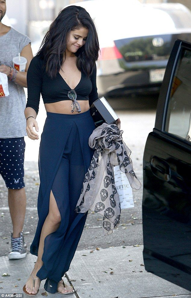 Selena Gomez Exposes Midriff And Hint Of Cleavage In