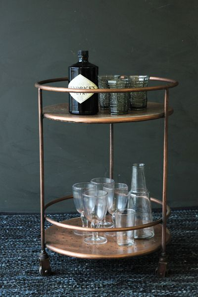 Serve cocktails at home with the amazing Shoreditch Drinks Trolley The cocktail trolley is created in copper effect metal and features two circular