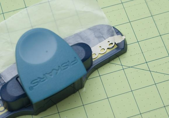 how to use a paper punch with masking tape: adhere the tape to wax paper, punch, then peel off